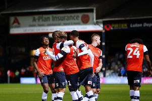Luton celebrate Andrew Shinnie's free kick making it 3-0 against Ipswich on Tuesday night