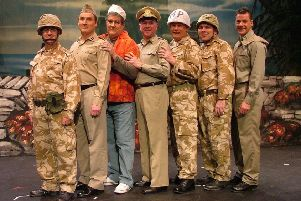 Ted Hutchin on stage (white helmet) in a Melton Mowbray Musical Theatre Company show EMN-190828-143619001