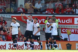 Luton celebrate Harry Cornick making it 3-0 at Barnsley last month