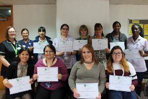Some of the workers with their certificates
