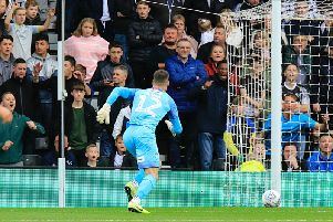 Simon Sluga chases a lost cause as Derby take the lead at Pride Park after his error