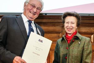 John Coyle receives his award from The Princess Royal