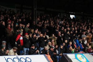 Town fans applaud owners 2020 during a home match last season