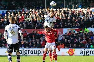 Hatters midfielder Glen Rea gets up to head away at Nottingham Forest