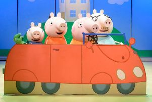 Peppa and family on stage