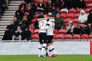Ryan Tunnicliffe is mobbed after scoring the winner today