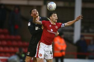 Lloyd Jones heads clear for Northampton at Walsall