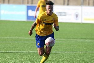 Jack Langford, pictured in action for Lancing, scored a hat-trick for Littlehampton Town against Oakwood. Picture: Derek Martin
