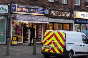 Police at the scene of Scott's Newsagents in Victioria Drive, Eastbourne (Photograph: Dan Jessup)