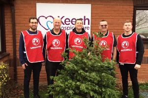 Recycling: The Vauxhall staff and the Christmas trees.