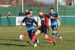 Fareham's Simon Woods competing with AFC Portchester's Marco Gambelardini and Steven Ramsey.  Picture: Vernon Nash (230219-124)