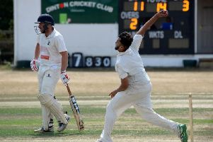 Dinton's skipper, Faisal Ali steams in