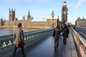 People walk across Westminster bridge next to the Houses of Parliament, London. PRESS ASSOCIATION Photo. Picture date: Wednesday November 14, 2018. Prime Minister Theresa May will put her Brexit plans to the Cabinet on Wednesday, 874 days after Britain voted to leave the European Union. See PA story POLITICS Brexit. Photo credit should read: Andrew Matthews/PA Wire PPP-181115-102749003
