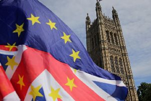 Pro-EU demonstrators wave an mixed EU and Union flag as they protest against Brexit, outside of the Houses of Parliament in central London on June 11, 2018. - After a rollercoaster week of Brexit rows within her government and with Brussels, British Prime Minister Theresa May will on Tuesday seek to avoid another setback in a long-awaited showdown with parliament. MPs in the House of Commons will vote on a string of amendments to a key piece of Brexit legislation that could force the government's hand in the negotiations with the European Union. (Photo by Daniel LEAL-OLIVAS / AFP)        (Photo credit should read DANIEL LEAL-OLIVAS/AFP/Getty Images) NNL-190213-092123005