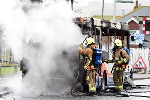 Firefighters tackle the flames. Pic: Dan Jessup