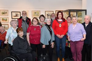 The Mayor of Mid and East Antrim, Cllr Lindsay Millar, with Carrickfergus Art Club members.