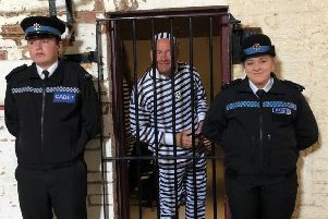 Cadets keep guard over one of the Jail and Bail 'prisoners'. Eastbourne Police 29-03-19