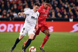 Valencia's French forward Kevin Gameiro vies with Real Madrid's French defender Raphael Varane during the Spanish league football match between Valencia CF and Real Madrid CF at the Mestalla stadium (Photo by JOSE JORDAN/AFP/Getty Images)