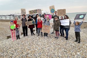 Youngsters strike against climate change on Eastbourne seafront SUS-190416-111602001