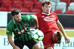 Kyle Neill (right) competing for Portadown during the final season of a memorable Irish League playing career.