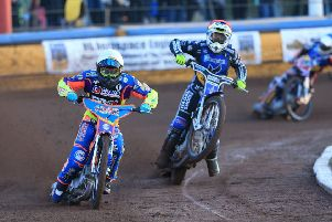 Somerset's Rory Schlein and Eastbourne Eagles captain Edward Kennett go wheel to wheel at Arlington in the Championship Shield