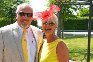 Clive and Debbie Jordan enjoy the sun on day one of Goodwood's May Festival / Picture by Malcolm Wells