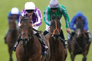 Magna Grecia leads on the way to 2000 Guineas success at Newmarket / Picture by Getty Images