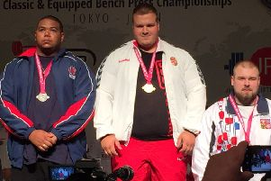 Joe Guest-Bourne. left, on the podium in Tokyo. Pictures submitted