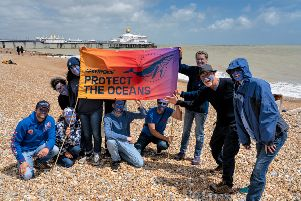 Eastbourne Greenpeace campaigners on the beach. Photos by Steve Malone. SUS-191106-154503001