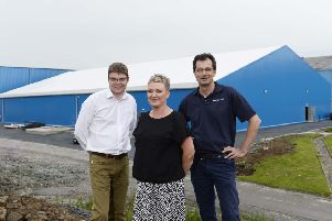 Pictured (L-R) are Steve Davey, Huhtamaki Fresh Project Manager, Jill Sloan, Human Resources Manager at Huhtamaki (Lurgan) and Richard Smith, General Manager of Huhtamaki (Lurgan), standing in front of the new factory at the Lurgan plant, specially built to produce Huhtamaki Fresh trays.