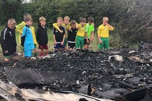 It's heartbreaking. Members of East Coast Juniors discover the fire that has destroyed their kit.