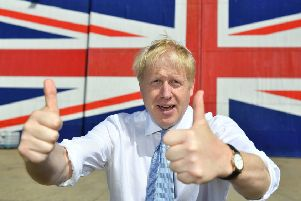 ISLE OF WIGHT, UNITED KINGDOM - JUNE 27: Conservative party leadership contender Boris Johnson poses for a photograph in front of a Union Jack on a wall at the Wight Shipyard Company at Venture Quay during a visit to the Isle of Wight on June 27, 2019 on the Isle of Wight, United Kingdom. Boris Johnson and Jeremy Hunt are the remaining candidates in contention for the Conservative Party Leadership and thus Prime Minister of the UK. Results will be announced on July 23rd 2019. (Photo by Dominic Lipinski - WPA Pool/Getty Images) PPP-190628-105619003