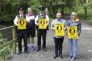 PSNI Constable Gary Truswell, David Crawford (Tandragee Recreation Centre), Constable Jack McFadzean, Chair of PCSP Councillor Thomas Larkham and Lynette Cooke (PCSP Project Coordinator) at the launch of the  Park Watch scheme at Clare Glen.