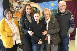 Kaitlyn Graham with family at the exhibition