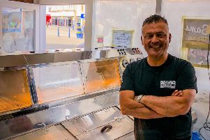 Sezign 'Sam' Cilek behind the counters in Sam's Tratidional Fish and Chip Restaurant. Picture: Quinstone UK