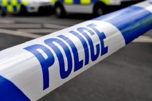 Police have arrested two men in the car park of a Sussex primary school