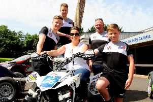 Dean Dillon (left) pictured with his biggest fans, mechanic Reece Boal, mum Leigh-Ann, dad Nigel and brother Ross.