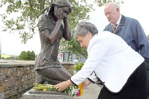 Mary Hamilton, who was injured in the Claudy bombings on 'Bloody Monday' and David Temple, whose brother David was murdered in the attack at the village memorial on a previously anniversary. Photo: Margaret McLaughlin � please by-line