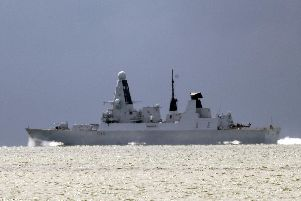 HMS Defender passes the Isle of Wight after leaving Portsmouth Harbour. PRESS ASSOCIATION Photo. Picture date: Monday August 12, 2019. Photo credit should read: Steve Parsons/PA Wire