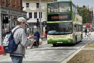 Buses and pedestrians in Terminus Road, Eastbourne (Photo by Jon Rigby)