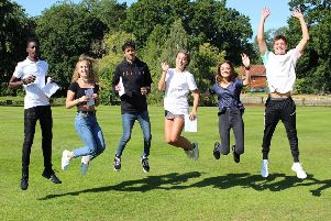 Bede's students celebrating their GCSE results