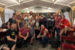 Leamington supported living scheme resident Adrian (centre and holding title belt) met some British wrestling heroes at a show recently.
