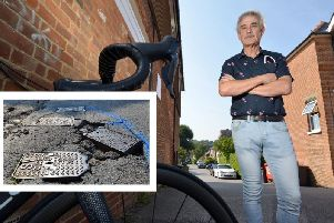 Andy Archer with his bike and the pothole (inset). Photo by Peter Cripps