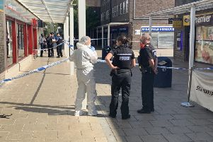 Police have cordoned off part of the shopping precinct in Broadfield, Crawley