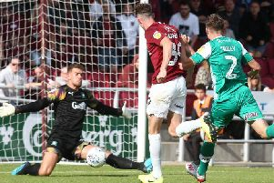 Joe Bunney almost scored his first Cobblers goal on what turned out to be his last appearance for the club, denied by Plymouth's Alex Palmer. Picture: Pete Norton