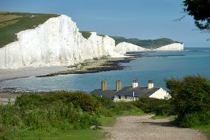 The Seven Sisters coastguard cottages are under risk of being destroyed by the sea. Photo by Peter Cripps