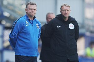 Coventry manager Mark Robins, left     Picture: Joe Pepler
