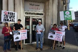 Portsmouth and South Downs Palestine Solidarity Campaign demonstrators outside the HSBC bank in Commercial Road, Portsmouth, for a protest against the firm because it invests in and provides financial services for companies providing military technology and weapons to Israel.