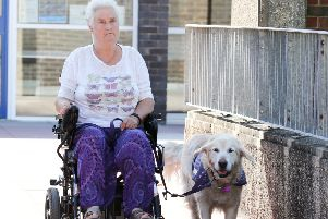Sue Sherlock with her assistance dog Lancelot