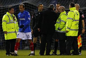 Avram Grant confronts referee Kevin Friend during Pompey's Premier League game against Sunderland in February 2010